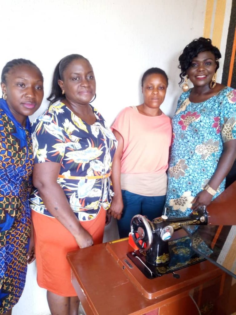 WCM Presents Sewing Machine to A woman in Lagos